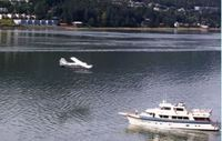 A plane landing in Juneau Harbor