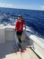 Fishing Charter.  My son reeled in that huge Wahoo.