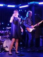 The lovely and talented Valeria Rivna onstage in The Fat Cats Lounge accompanied by the electric guitar of Cornell Bratila of the ships band Let's Groove entertaining passengers with their smooth sounds.