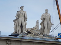 Statues on top of the buildings adjacent to Alexander II Square, St. Peters