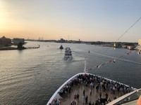 Being led out of Amsterdam harbor by Viking River ship