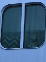 Plushies in cabin window as seen from port