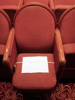 This is one of the seats in the Princess Theatre.  The paper is a standard