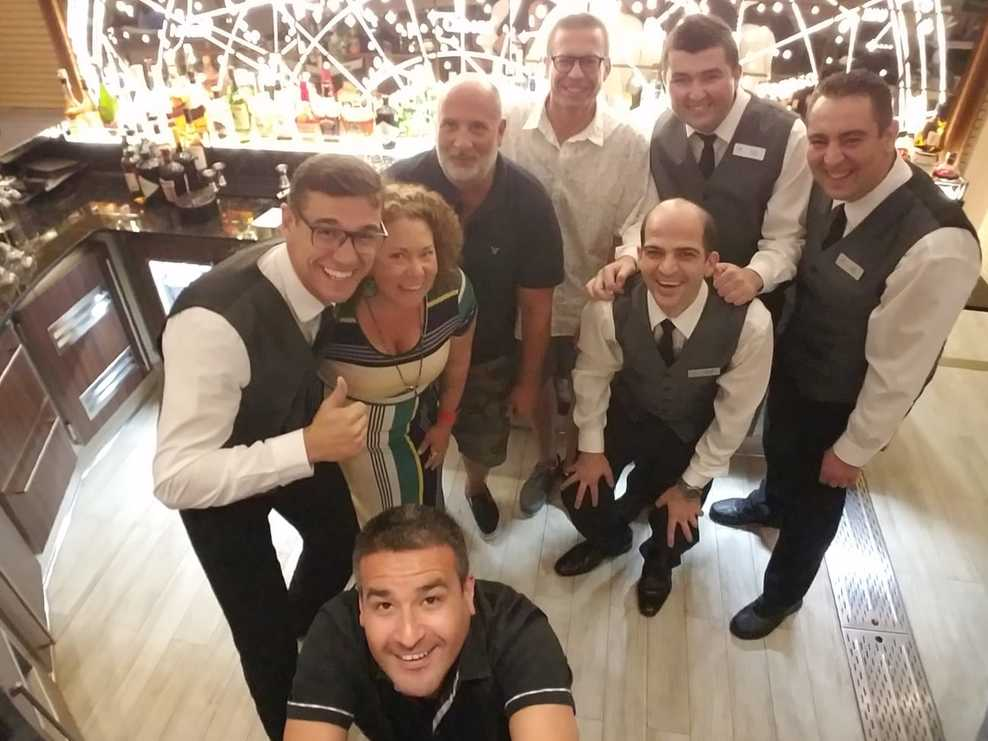 Us with all our bar staff friends behind the bar on the last night.