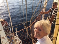 Author having climbed rigging with deck below