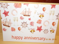 Princess Cruises anniversary poster posted outside cabin door with new logo