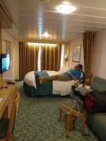 Stateroom 6330. Roomy. Bed, curtains and carpet could stand to be replaced.