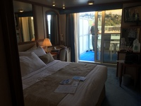 Our balcony room. View on deck, refrigerator, bottle of wine in the fridg;
