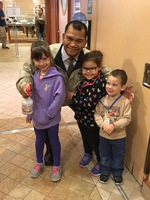 My niece, nephew and granddaughter with Red. They loved his energy and sing