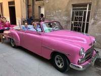 One of the 3 pink convertibles we had on our tour in Havana