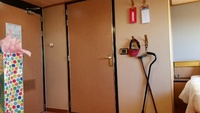 View of cabin door (left) and bathroom door straight ahead. Closeness of be