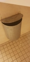 Obsolete Rubbish bin in bathroom, still had rubbish in it,  made of tin and