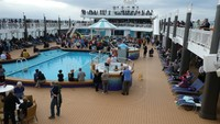 Embarkation high jinks on pool deck.