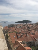 Walking the walls of Dubrovnik with Azamara in the distance.  Tendered port