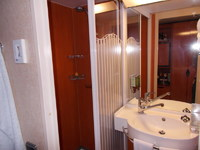 shower on the left, with glass door