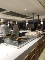 Excellent chef staff preparing a la carte in the main dining room.