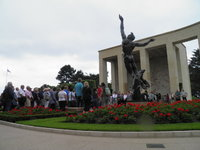 The American Cemetery at Omaha Beach, Brenton leading moment of silence.