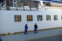 Crewmembers power-washing the ship!