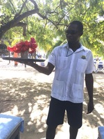 Our cabana server.  His name is Rolex!  He brought flowers for my sister'