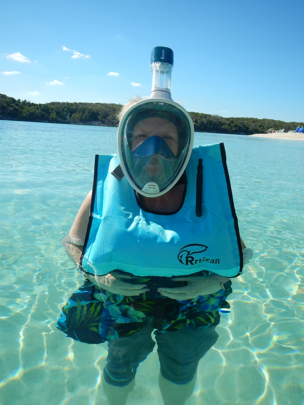Enjoying my snorkel mask on Blue Lagoon Island.  It's a great way to se