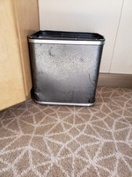 This trash can in our stateroom has seen better days.