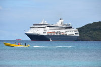 Ship off Dravanui Island and islanders taking some passengers for ride arou