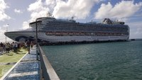 The Crown Princess sitting at harbor in Martinique.
