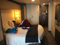 Cabin with entry door, corner bathroom and large bed. My other room picture