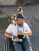 In St. Kitts, men walking around with monkeys let you take pictures for mon