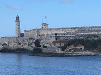 Pulling out of Havana. the lighthouse and fort