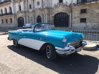 Old car behind the cathedral in Havana