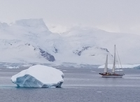 sailboat cruising among the icebergs