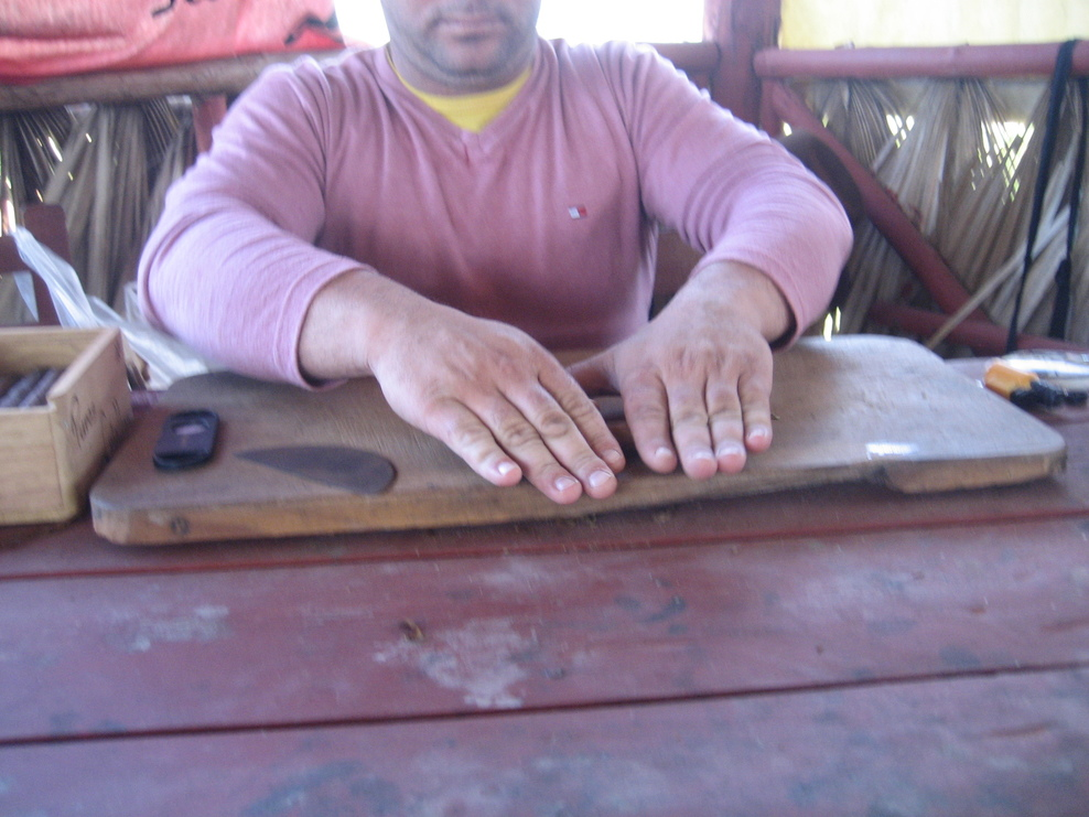 Hand rolling Cigars at a farm in Vinales National Park