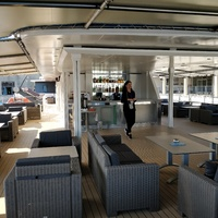 Covered, outdoor lounge and bar area on 4th deck