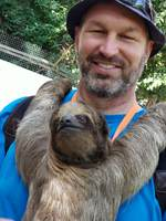 Holding a sloth named Betty.
