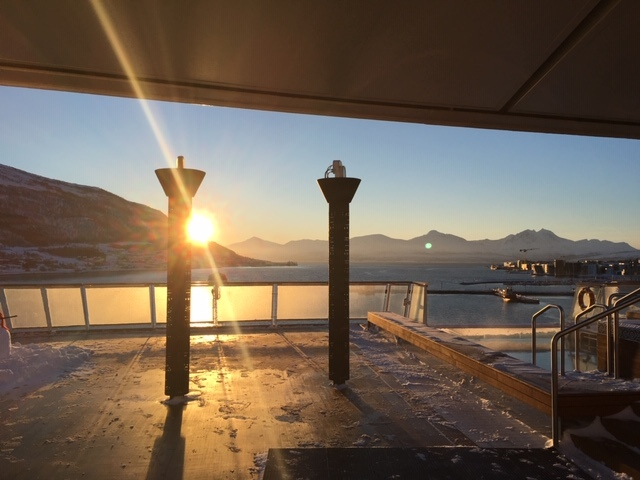 Noon Sun in the port of Tromso, looking aft from the ship.