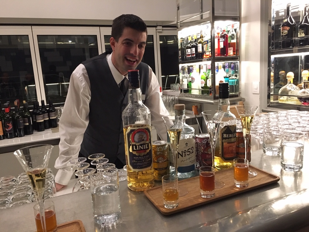 Our bartender conducting a tasting of Aquavit and Norwegian Beer.