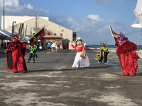 Being greeted by Carnival costumed dancers in Ponce, Puerto Rico