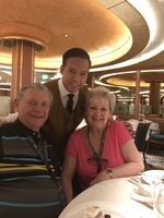 Us in the dining room with our waiter last night of cruise