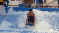 Teen on boogie board on Flowrider.