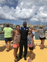Mom and Sister with our Concierge Dexter during the San Juan sail away