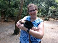 Holding a baby monkey at the preserve