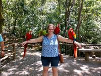 Holding the parrots at the preserve in Honduras.