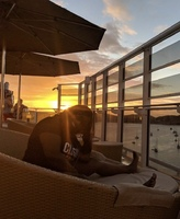 Me enjoying the beautiful sunset from the private Haven deck. It was very r