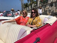 Car ride in a 1952 Ford convertible with a Honda engine in Havana.