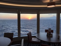 Sunrise from aft corner of Garden Cafe — the buffet on Deck 16 aft.  Alwa