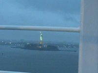 going past Statue of Liberty while raining
