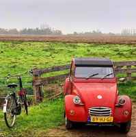 A bicycle and a Deux Chevaux in Holland at Zaanse Schans.