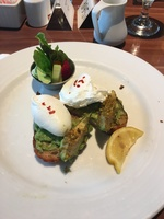 Yummy avocado toast with poached eggs