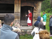 Kristiansand Open Air Museum Guide donning period costume